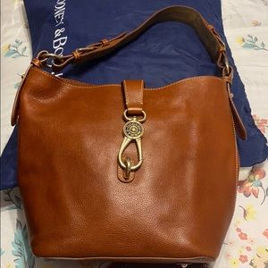 Brown leather Dooney & Bourke purse and wallet.